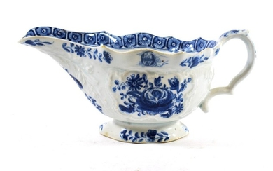 A Bow Porcelain Sauce Boat, circa 1765, painted in underglaze...