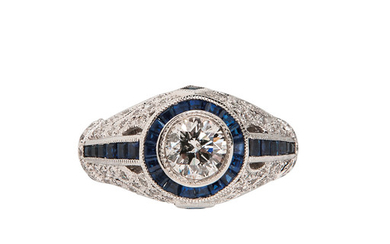 18kt White Gold, Sapphire, and Diamond Solitaire