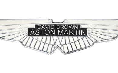 A painted cast aluminium sign depicting the David Brown Aston Martin emblem,
