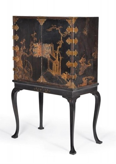 A black lacquer and gilt chinoiserie decorated cabinet on stand
