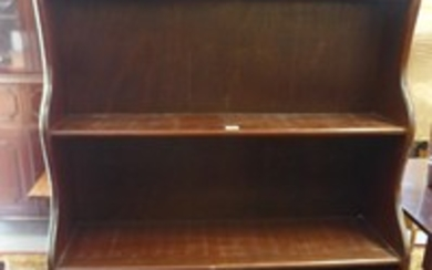 A 20th century mahogany waterfall front bookcase with single...