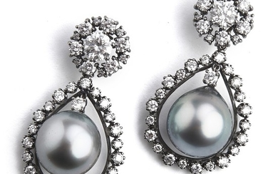 Hartmann's: A pair of Tahiti pearl and diamond ear pendants each set with a Tahiti pearl and diamonds, totalling app. 4.32 ct., mounted in 18k white gold. (2)