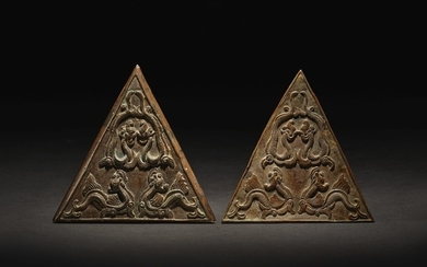 A PAIR OF EXCEEDINGLY RARE SILVER 'MAKARA' PLAQUES SONG DYNASTY