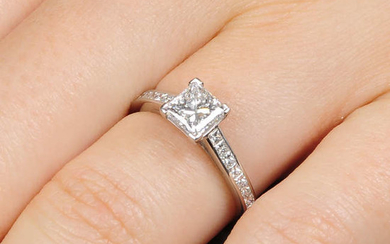 A platinum square-shape diamond single-stone ring, with