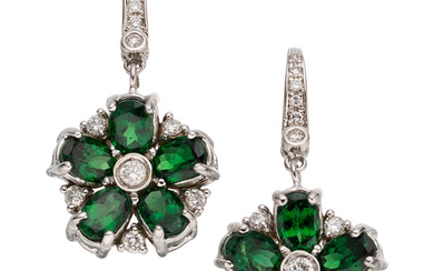 Tsavorite Garnet, Diamond, White Gold Earrings The earrings feature...