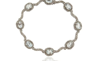 An aquamarine and diamond bracelet, set with aquamarine...