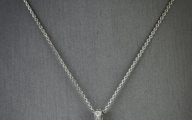 Diamond, ruby, and platinum pendant necklace