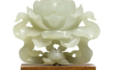 A PALE CELADON JADE CARVING OF A PEONY QING DYNASTY, 18TH/19TH CENTURY