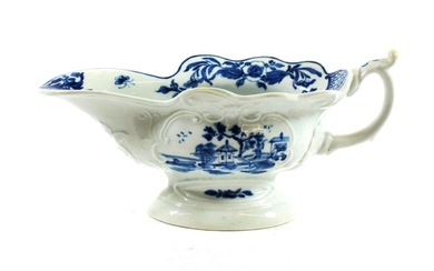 A Worcester Porcelain Sauceboat, circa 1755, painted in underglaze blue...