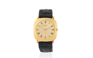 Patek Philippe. An 18K gold manual wind cushion form wristwatch
