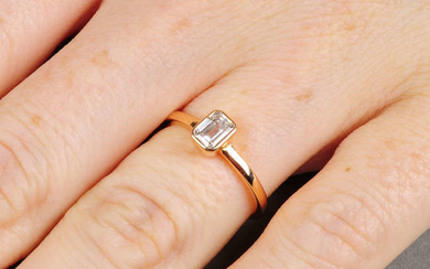 A rectangular-shape diamond single-stone ring. With