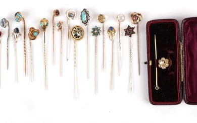Eighteen Stick Pins; including a garnet and houndstooth pearl example,...