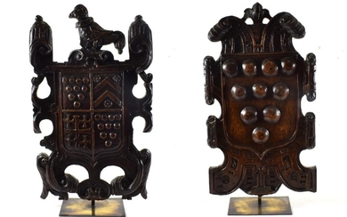 An Oak Armorial Plaque, 18th century, carved with a bird...