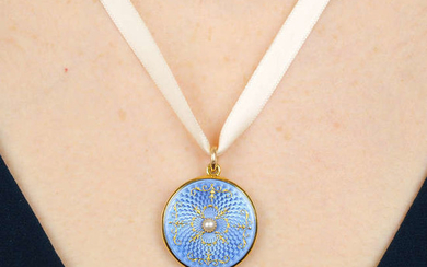 An early 20th century gold, guilloche blue enamel and split pearl locket.