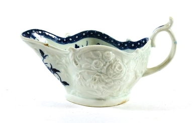 A Worcester Porcelain Sauceboat, circa 1765, painted in underglaze blue...