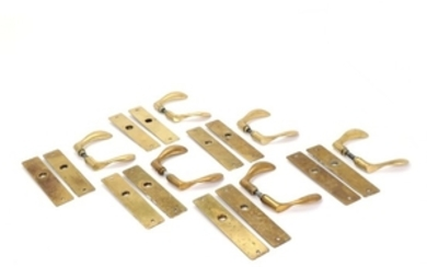 """1907/561: Arne Jacobsen: """"AJ"""". Six sets of patinated brass handles with matching fittings. (6)"""