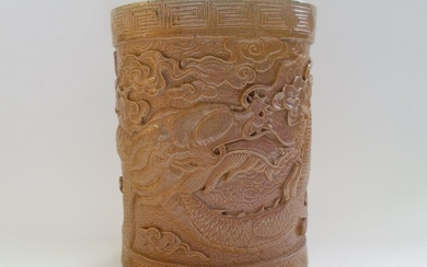 A Chinese Glazed Pottery Brush Pot Decorated With A Carved Dragon