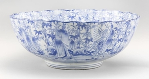 """BLUE AND WHITE PORCELAIN BOWL In flower form with transfer design of sages in a bamboo grove. Diameter 15.6""""."""