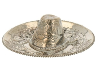 Miniature mexican sombrero decorated with floral hammered decorations silver.