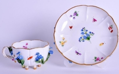 A MEISSEN ENCRUSTED PORCELAIN CUP AND SAUCER encrusted