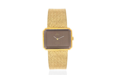 Omega. An 18K gold manual wind octagonal form bracelet watch
