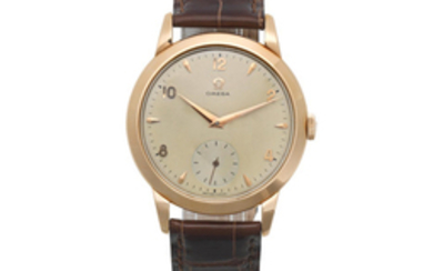 Omega. An 18K gold manual wind wristwatch