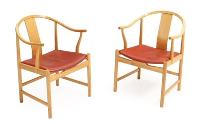 "Hans J. Wegner: ""Chinese Chair"". A pair of cherry wood armchairs, seats with red leather. Manufactured and stamped by PP Furniture, 1997. (2)"