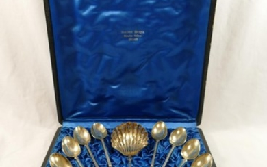 A set of 12 French silver teaspoons and a large sifter spoon...