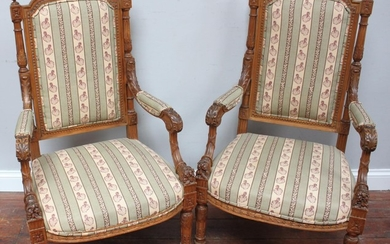 A pair of 19th century French walnut open armchairs, with fi...