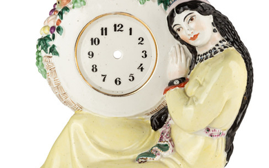 A RUSSIAN PORCELAIN TABLE CLOCK CASE IN THE SHAPE OF A SEATED UZBEK WOMAN AFTER NATALYA DANKO (RUSSIAN 1892-1942), LENINGRAD