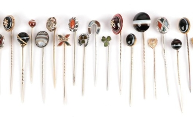 Twenty-Three Stick Pins; including a carbuncle garnet and seed pearl...