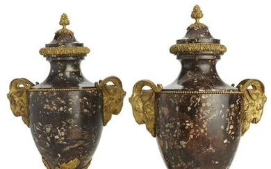 A pair of Louis XVI style marble urns