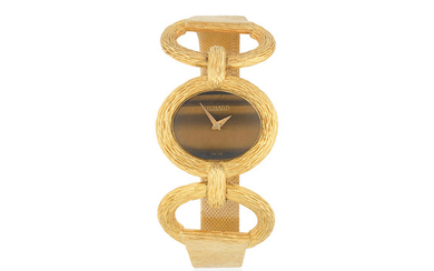 Richard. A lady's 18K gold manual wind oval bracelet watch with tiger's eye dial