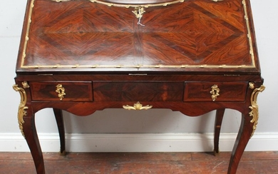 An 18th Century French rosewood and gilt bronze mounted bure...