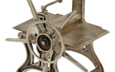 Miniature cloth press silver.