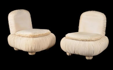 A pair of American 'Hollywood Regency' lounge chairs