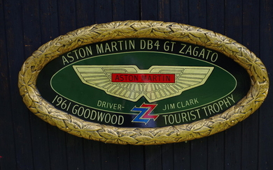 A hand-painted 'Aston Martin DB4 GT Zagato' celebratory oval plaque,