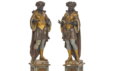 A pair of Venetian Polychrome Decorated Carved Wood Figures