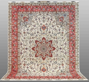 A carpet, Täbriz part silk, s.k 50 Radj, signed, ca 395 x 295 cm. |
