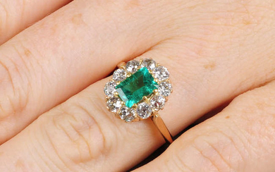 A Colombian emerald and old-cut diamond cluster ring.