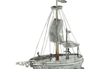 A model of a sailing ship in molten, embossed, chiselled and perforated silver. Fantasy marks for the ...