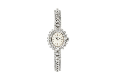 Omega. A lady's 18K white gold and diamond set manual wind bracelet watch