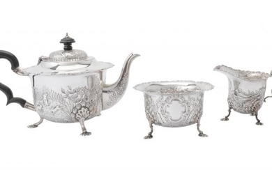 A silver shaped circular three piece tea service by S. Blanckensee & Son Ltd