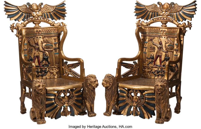A Pair of Egyptianesque Carved and Painted Wood Throne Chairs