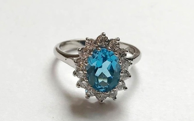 Large blue topaz and diamond cluster ring, on 18ct white gol...