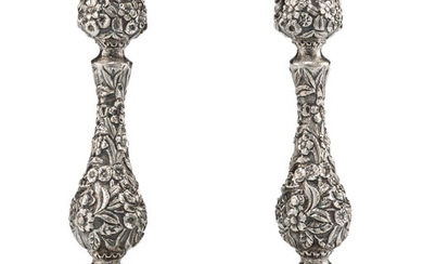 A Pair of S. Kirk & Son Repoussé Silver Weighted Candlesticks (1925-1932)