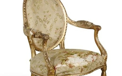 A George III carved giltwood armchair