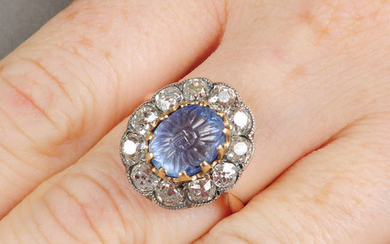 A foliate carved sapphire and old-cut diamond cluster ring.