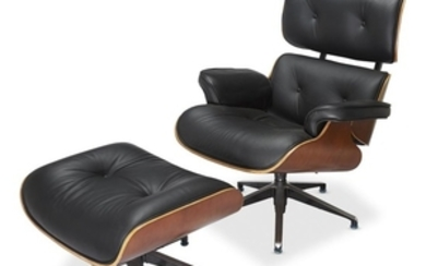 An American mid-century style walnut and leather lounge chair...