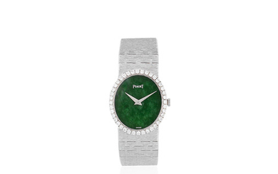 Piaget. A lady's 18K white gold and diamond set oval bracelet watch with green hardstone dial